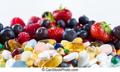 Healthy lifestyle, diet concept, Fruit and pills, vitamin supplements with on white background