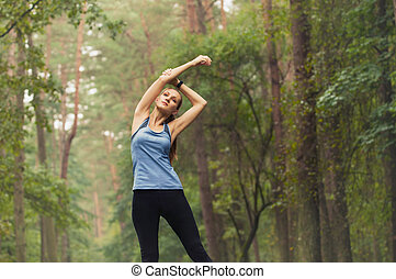 healthy lifestyle fitness sporty woman stretching before run...