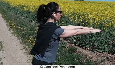 Healthy lifestyle fitness woman warm up before running on country road