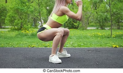 Healthy lifestyle fitness woman warmup legs before workout outdoors in the city park