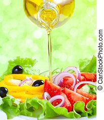 Healthy lifestyle. Fresh salad with oil. Food still life.