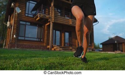 Healthy lifestyle. Girl running around in the morning in a premium residential area