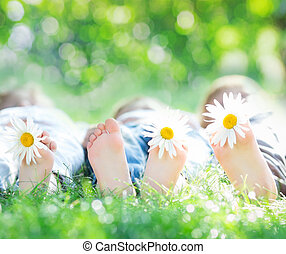 Healthy lifestyle - Healthy feet of family with daisy...