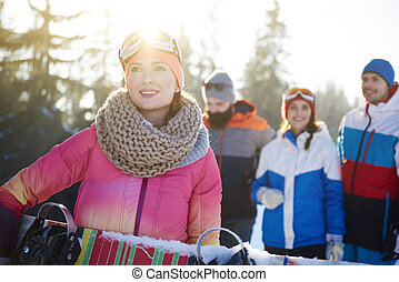 Healthy lifestyle image of happy snowboarders