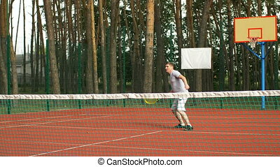 Healthy lifestyle man playing tennis outdoors