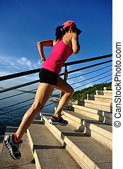 healthy lifestyle sports woman running up on stone stairs...