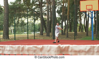 Healthy lifestyle sporty man playing tennis outdoor