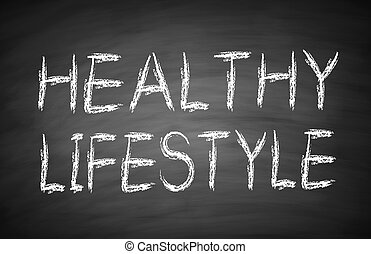 Healthy lifestyle text is written by white chalk on...