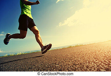 healthy lifestyle woman runner running on road
