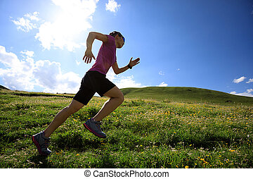 healthy lifestyle woman trail runner running on mountain...