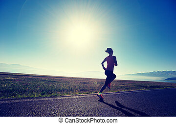 healthy lifestyle young fitness woman runner running on road