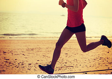 Healthy lifestyle young fitness woman running at sunny beach