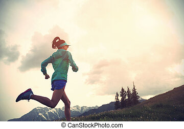 healthy lifestyle young fitness woman trail runner running on beautiful mountain peak