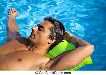 Healthy lifestyle: young man at the swimming pool