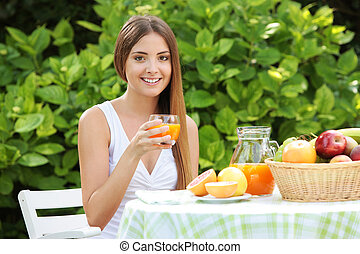healthy lifestyle - Young woman relaxes in the garden ...