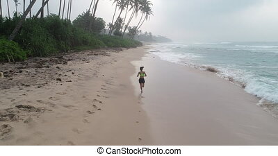 Healthy lifestyle young woman running on tropical beach...