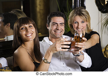 healthy living: friends at a restaurant having fun together
