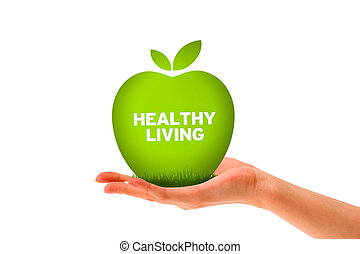 Healthy Living - Hand holding a green healthy living apple.