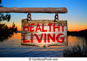 Healthy living sign with sunset blurred background