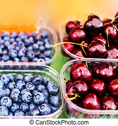 Healthy local food concept with assorted berries on display...