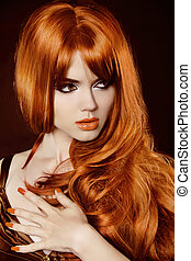 Healthy Long Hair. Beautiful woman with red curly hair and evening make-up over black. Manicured Nails.
