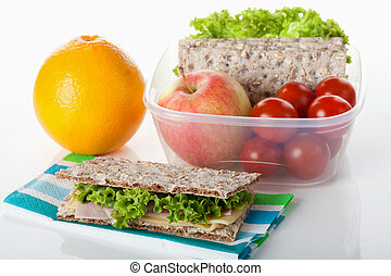 Healthy lunch box filled with fresh fruits, vegetables and crispbread