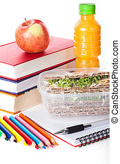 Healthy lunch with school supplies