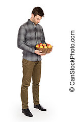 Healthy man with bowl full of apples