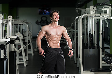 Healthy Man With Six Pack - Young Man Standing Strong In The...