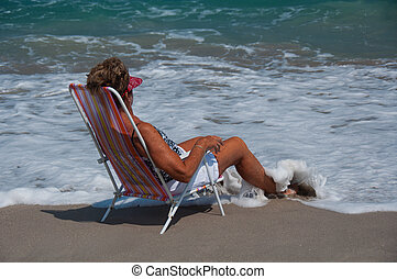 Healthy, Mature Woman Relaxing on a Florida Beach - A...