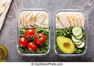 Healthy meal prep containers with chicken, rice and salad