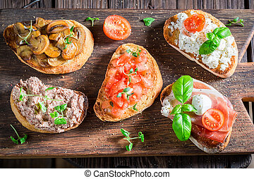 Healthy mix of bruschetta with fresh ingredients for a snack