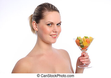 Healthy mixed fruit cocktail for young woman