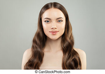 Healthy model woman with clear skin and perfect hair. Spa beauty portrait