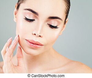 Healthy Model Woman with Skin touching her Hand her Face. Skincare, Facial Treatment and Cosmetology