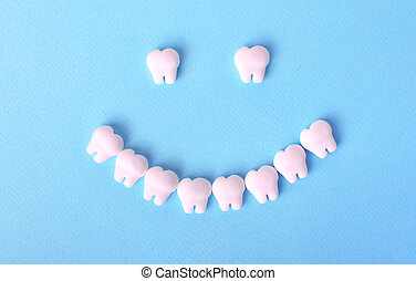 Healthy mouth concept with smile made with toy teeth. Dental background.