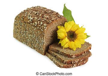 Sliced multi-grain-bread with sunflower blossom on white backgroud