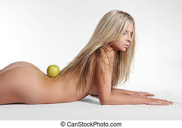 Healthy naked woman body with fresh apple over white