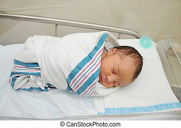Healthy Newborn Infant Baby with Pacifier in the Background Sleeping in Hospital Acrylic Bassinet