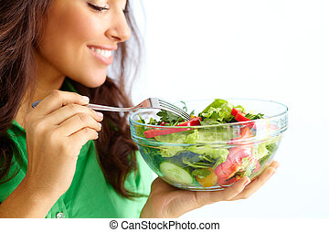 Healthy nutrition - Close-up of pretty girl eating fresh ...