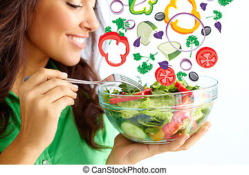 Healthy nutrition - Close-up of pretty girl eating fresh...