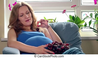 Healthy nutrition in ninth pregnancy month. Happy smiling...