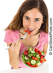 Healthy nutrition woman eating salad
