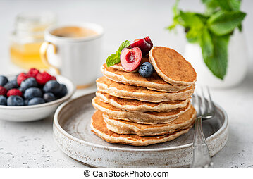 Healthy oat pancakes with berries