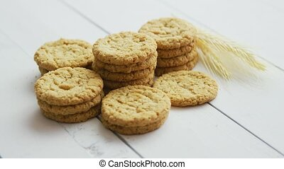 Healthy oatmeal cookies on white wood background, Side view....