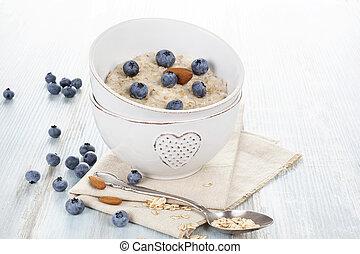 Healthy oatmeal porridge with berries.