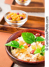 Healthy oatmeal with berries, raisins and herbs