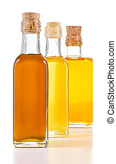 Healthy oils with unsaturated fats. Nigella sativa oil, poppy seed oil and flax oil in a bottle isolated on white background. Cold pressed non refined oils.
