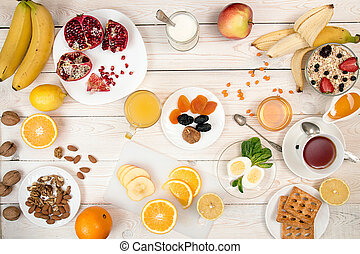 Healthy organic breakfast. Eggs, muesli, orange juice, honey, nuts, fruits