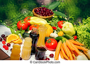 Healthy organic food and fresh fruit juices in jars